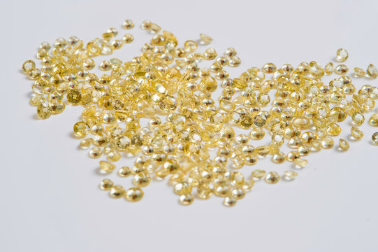 Group of little faceted yellow sapphires.