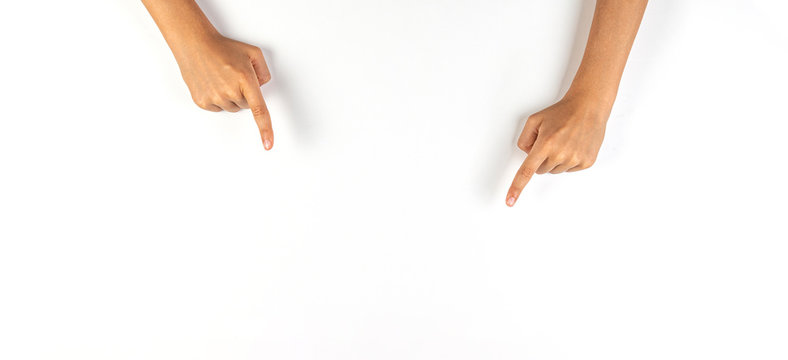 Kid hands pointing down with fingers to something on white background