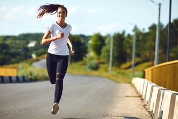 Fototapeta One young fitness girl runner running road obraz