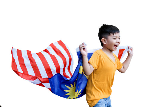 happy malaysian kid run around the house carrying malaysia flag