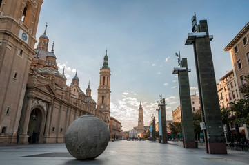 View of the Plaza de El Pilar de Zaragoza (Spain) with the Cathedral of El Pilar and the tower of the Cathedral of La Seo in the background, at dawn. Wall mural