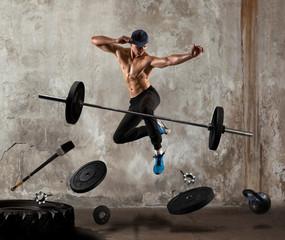 Bodybuilder break dancing. Mixed image