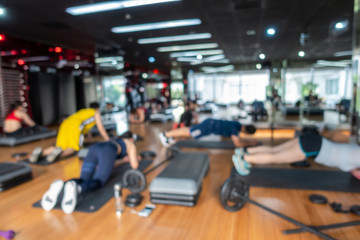 Blur Fitness class with group of people excercising with barbell, dumbbell Fototapete