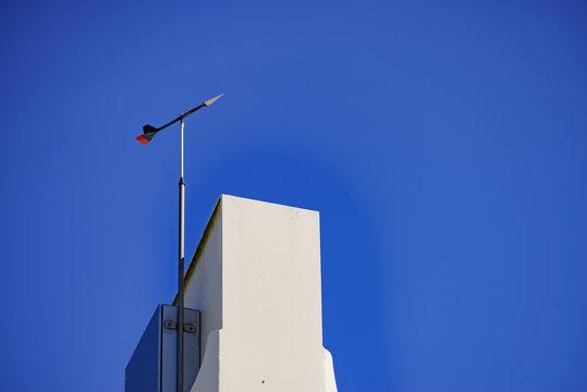 Wind indicator on chimney roof