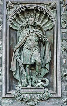 Element of decorative gates, statue of the Archangel Michael