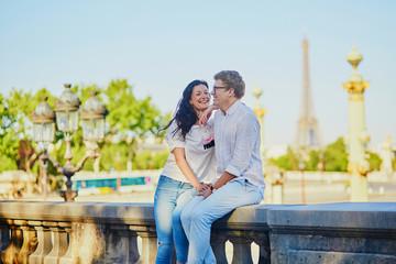 Happy romantic couple in Paris, in Tuileries garden