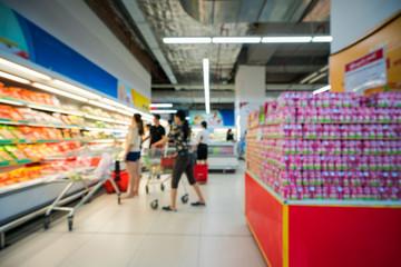 In de dag Muziekwinkel Supermarket blurred background with colorful shelves and unrecognizable customers