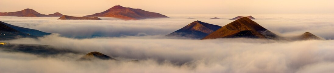 Lanzarote volcanic landscape shrouded in morning mists