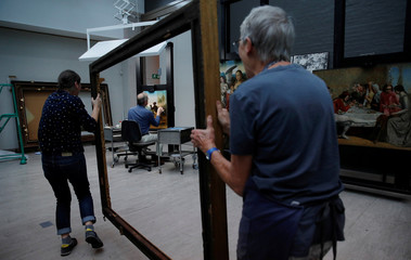 David Crombie, Senior Paintings Conservator at the National Museums, Liverpool carries out restoration work on the painting 'Am Not I A Man And A Brother', one of only 2 known paintings of its type in existence in Liverpool, Britain, July 30, 2019. Picture
