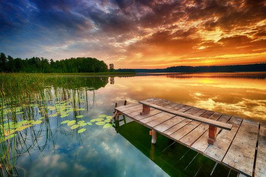 Beautiful summer sunrise over lake