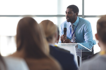 Male speaker speaks in a business seminar
