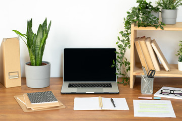 Supplies and equipment for business or educational purposes on wooden desk