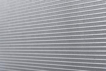 Car radiator mesh texture closeup.