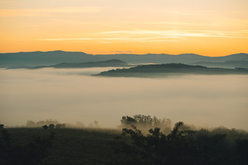 Recess Fitting Gray traffic view of sunrise over the mountains mist and clouds under peaks