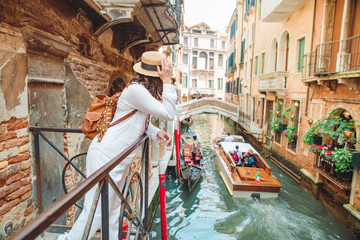 Poster Venice woman looking at canal with gandola