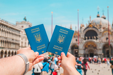 hand holding ukrainian biometric passports travel concept freedom of movement