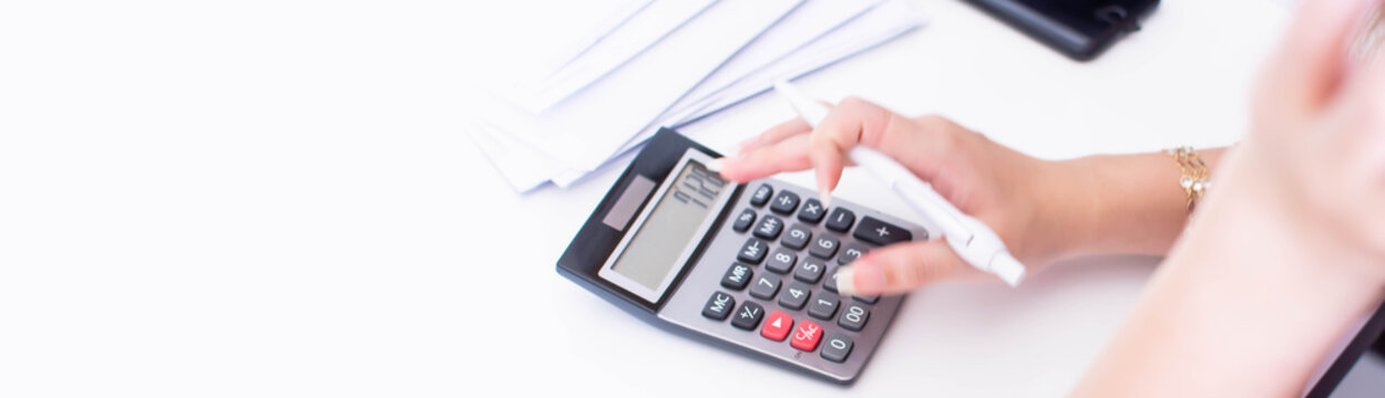 Banner of hand and calculator on white table