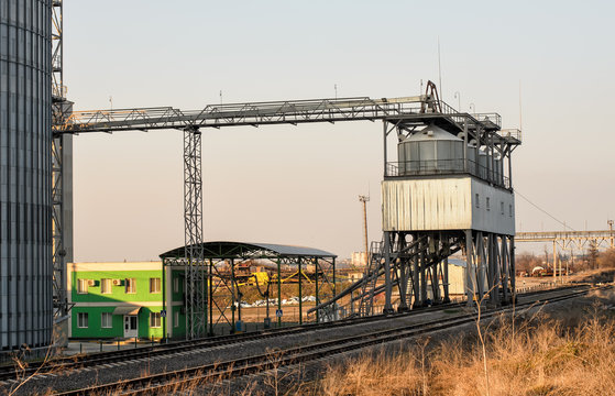 Modern sugar factory, metal silo for sugar or grain storage, buildings, railway and special equipment to load railway carriages, industrial landscape