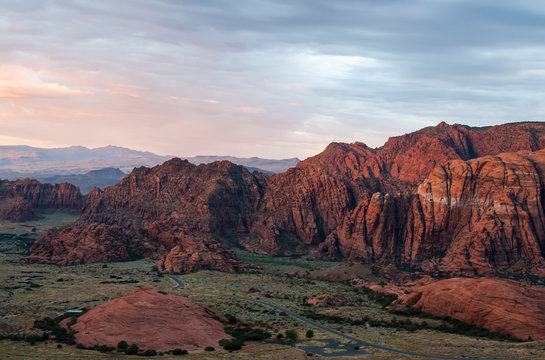 Sunset above the red sandstone mountains at Snow Canyon State Park in Utah