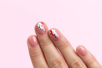 Bright fashionable abstract manicure on female hand