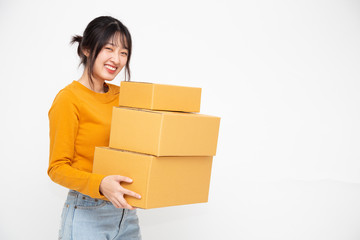 Happy Asian woman holding package parcel box on white background, Delivery courier and shipping service concept