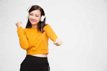 Asian woman listening music with headphones in playlist song application on smartphone, Hipster young girl concept
