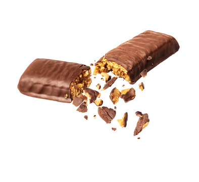 Chocolate bar crushed in the air isolated on a white background