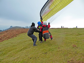 Tandem Paraglider launching yellow wing