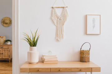 Stylish and modern boho interior of living room with mock up photo frames, flowers in vase, wooden desk, beige macrame and elegant accessories. Design home decor. Bohemian concept. Mockup ready to use Wall mural