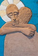 Bratislava, Slovakia. 2018/5/22. A relief sculpture of Jesus Christ embracing a person. Made out of modelling clay by Lubo Michalko. Displayed in the Quo Vadis Catholic House.