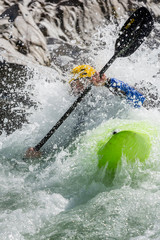 New Zealand, Murchison. A man paddles a kayak down a rapid on the Matakitaki River.