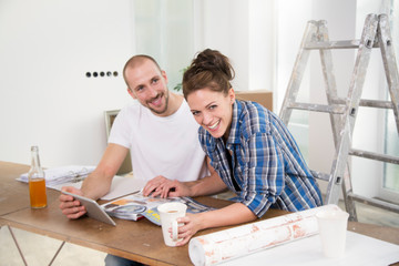 Young couple moving into new home,taking a break