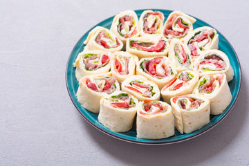 Sliced sandwich tortilla with vegetables and ham