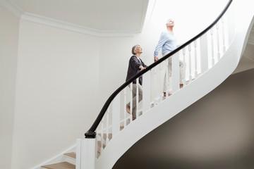 Foto op Plexiglas Centraal Europa Germany, Berlin, Senior couple climbing stairway