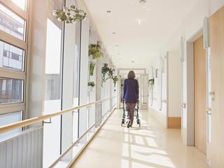 Senior woman with walking frame in nursing home