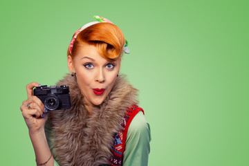 Amazed pinup style woman girl with digital camera