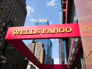 New York, New York, USA - May 31, 2012: A Wells Fargo sign at a Wells Fargo location in Midtown Manhattan. Manhattan buildings can be seen in the background.