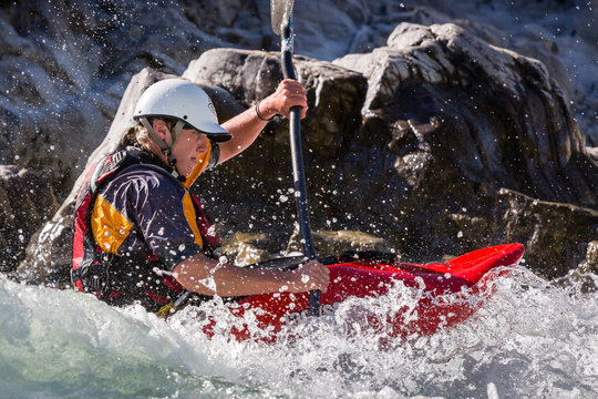 Woman kayaking in Buller River water rapids