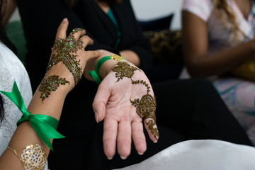 Closeup of moroccan women hands with henna decoration.