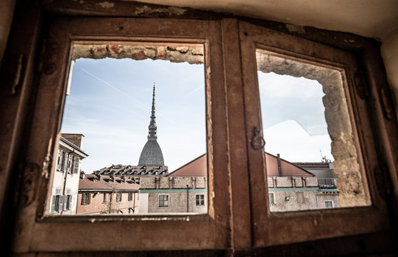 The Mole Antonelliana Captured From An Old Broken Window. Turin, Piedmont, Italy