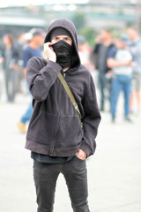ANTIFA supporter at a protest on a nice day.