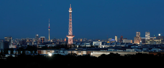 The city's skyline is pictured with the TV tower and radio tower during the evening in Berlin