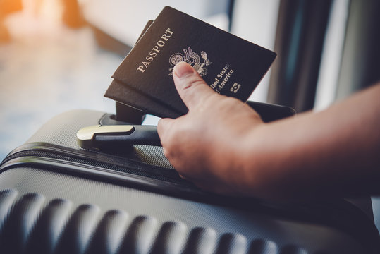 People holding passports, map for travel with luggage for the trip