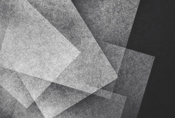 black and white abstract background with angled blocks, squares, diamonds, rectangle and triangle shapes layered in abstract  modern art style background pattern, textured background