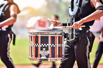 Close-up of marching band drummers marching