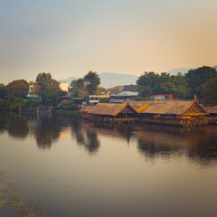 Fototapete - Sunrise over the river Kwai, Kanchanaburi, Thailand