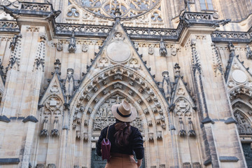 Wall Mural - Tourist woman traveling in Prague, Czech Republic in summer at Church Saint Vitus Cathedral