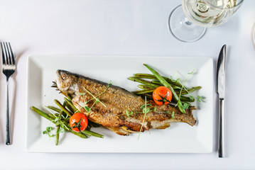 roasted trout with green beans Wall mural