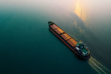Shipping cargo to harbor by ship. Water transport International. Aerial view - fototapety na wymiar