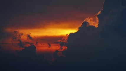 Fotobehang - Epic storm clouds moving over colorful sunset sky background. Timelapse, 4K UHD.